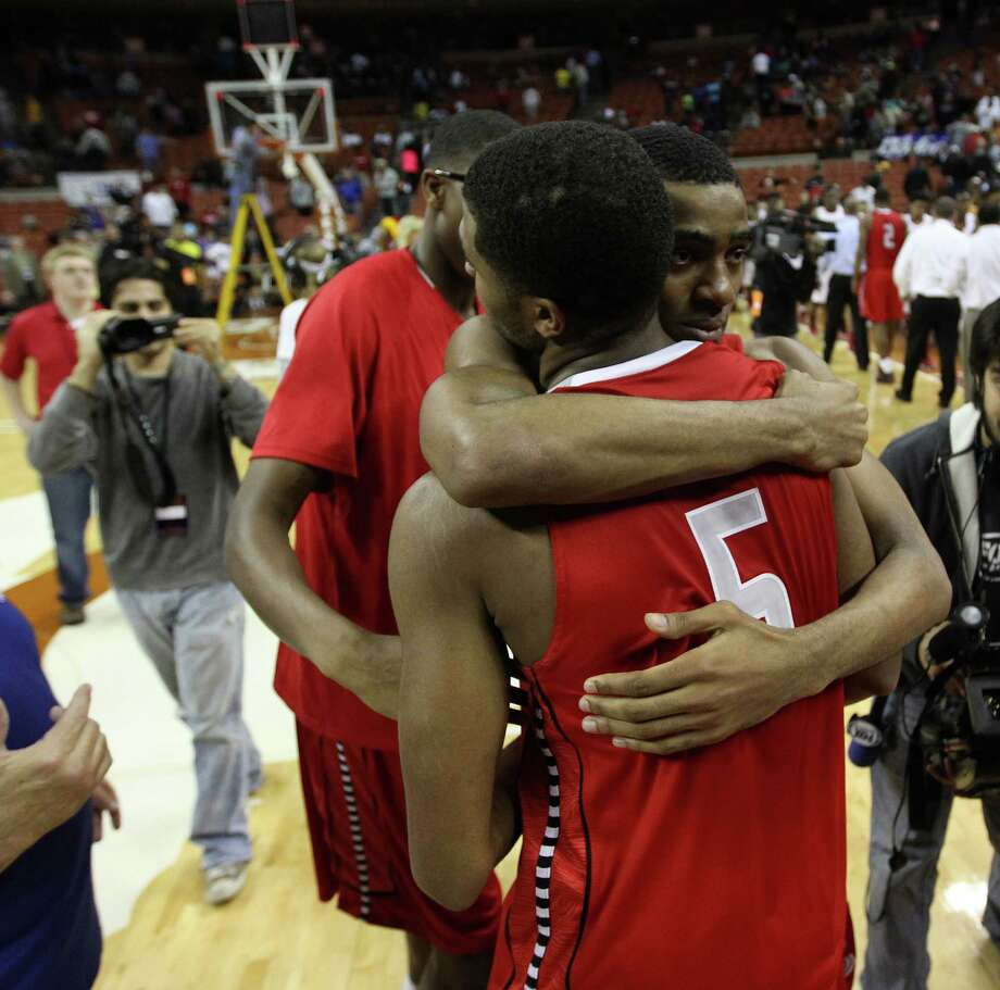 Travis Daniel Chika (4) hugs Andrew Harrison (5) after their win over South Grand Prairie. Photo: Karen Warren, Houston Chronicle / © 2013 Houston Chronicle