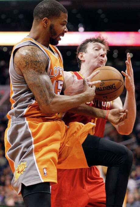 Rockets center Omer Asik, right, had 16 rebounds, but former Rocket Marcus Morris and the Suns found plenty of offensive boards and second-chance points. Photo: Paul Connors, FRE / FR5880 AP
