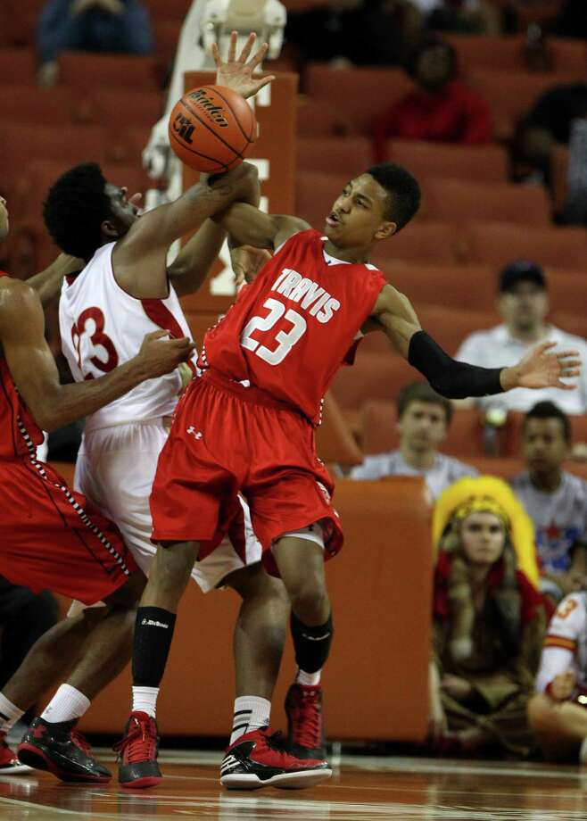 Travis' Tyronne Jordan (23) gets tangled up with South Grand Prairie's Jalon Anderson (23) during the second half of the UIL 5A boys state basketball championship game between Fort Bend Travis and South Grand Prairie at the Frank Erwin Center, Saturday, March 9, 2013, in Austin. Travis won the game. Photo: Karen Warren, Houston Chronicle / © 2013 Houston Chronicle