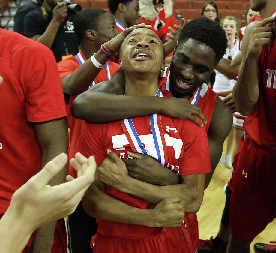 5A championship gameFort Bend Travis 46, South Grand Prairie 38Fort Bend Travis players celebrate  after their win over South Grand Prairie after the UIL 5A boys state basketball championship game. Photo: Karen Warren, Houston Chronicle / © 2013 Houston Chronicle