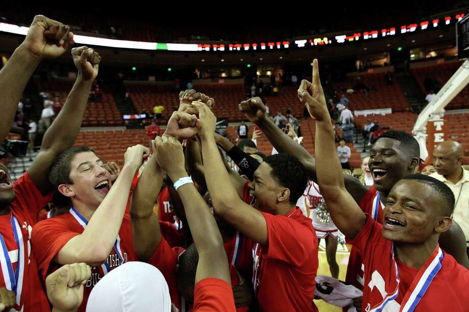 Travis players celebrate their state championship win. Photo: Karen Warren, Houston Chronicle / © 2013 Houston Chronicle