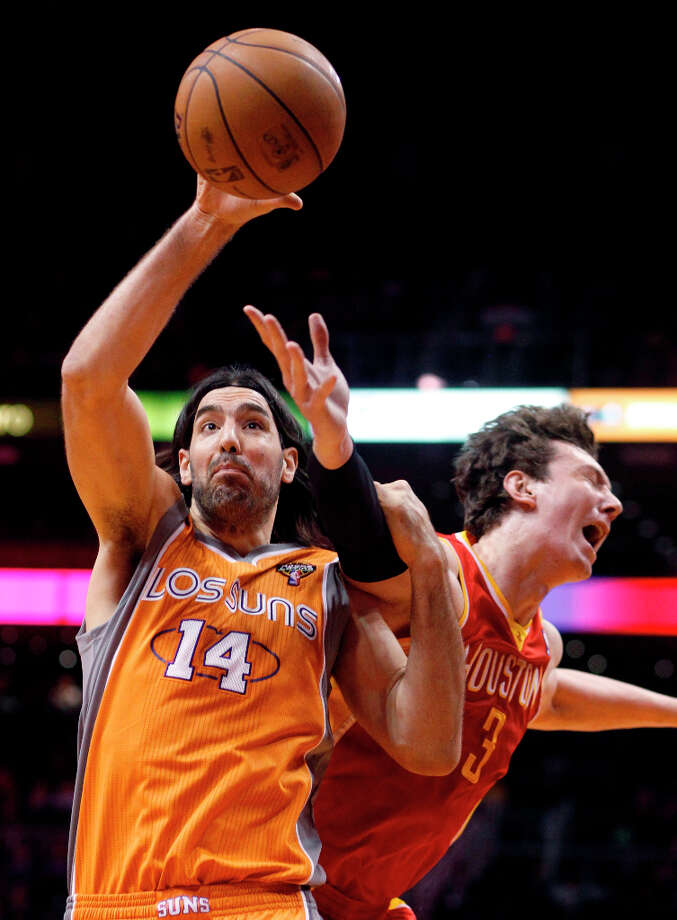 March 9: Suns 107, Rockets 105Former Rocket and current Suns forward Luis Scola grabs control of a rebound over Rockets center Omer Asik. Photo: Paul Connors