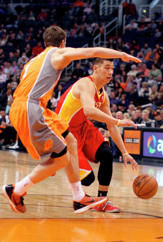 Goran Dragic of the Suns defends Jeremy Lin of the Rockets. Photo: Paul Connors
