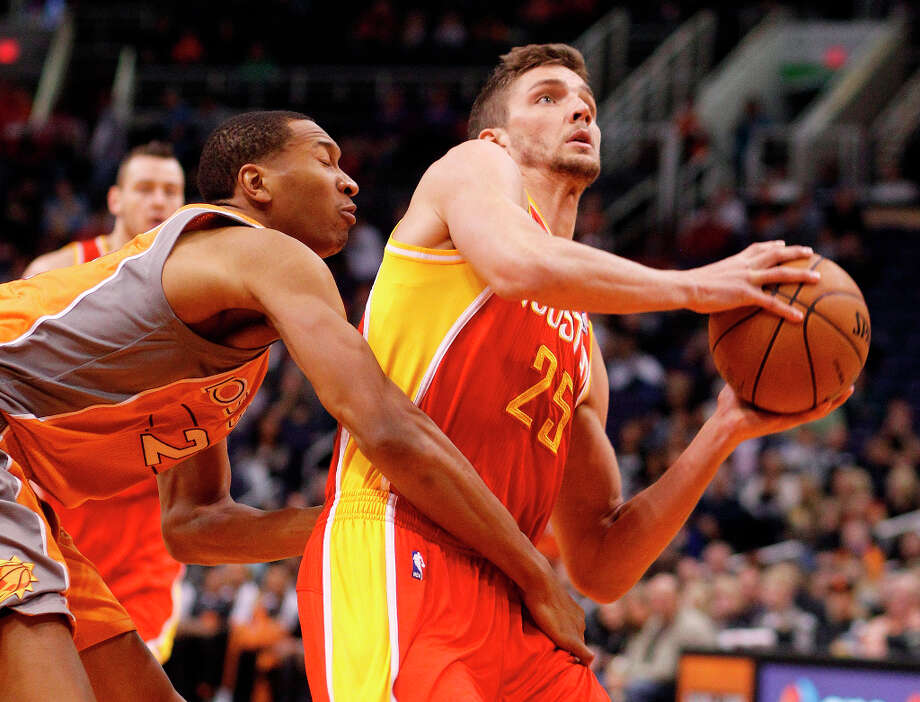 Rockets forward chandler Parsons is fouled by Wesley Johnson of the Suns. Photo: Paul Connors