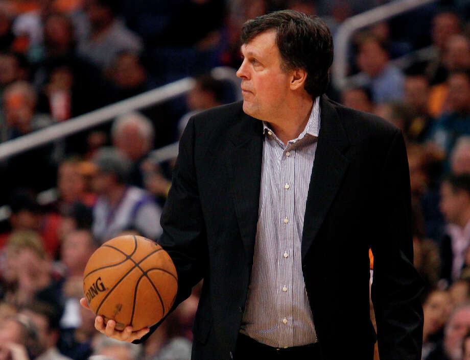 Rockets coach Kevin McHale grabs the ball as he calls a timeout. Photo: Paul Connors