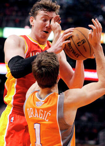 Goran Dragic of the Suns and Omer Asik of the Rockets battle for possession. Photo: Paul Connors
