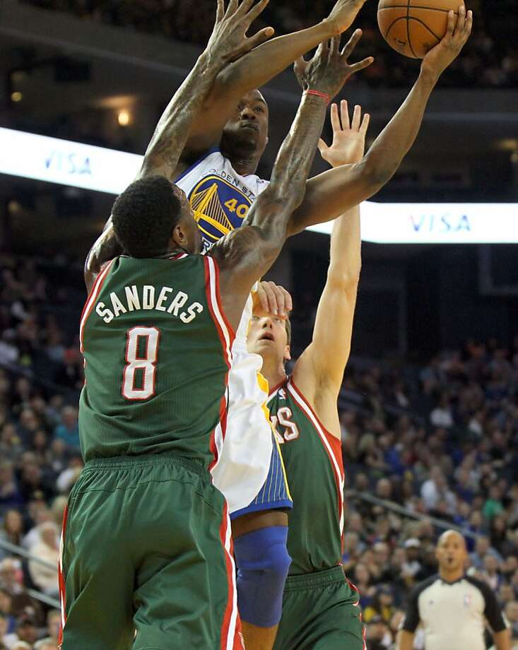Golden State Warriors forward Harrison Barnes (40) shoots between two Milwaukee Bucks defenders in the first half of their NBA basketball game Saturday, March 9, 2013, in Oakland Calif. Photo: Lance Iversen, The Chronicle