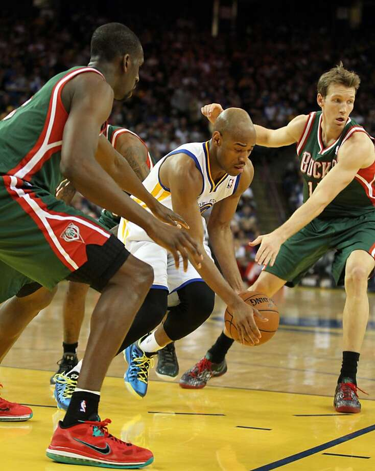Golden State Warriors guard Jarrett Jack (2) drives inside the key between two Milwaukee Bucks defenders in the first half of their NBA basketball game Saturday, March 9, 2013, in Oakland Calif. Photo: Lance Iversen, The Chronicle