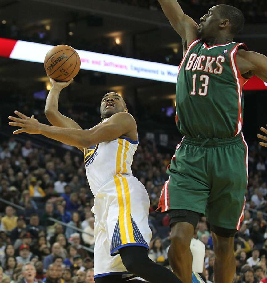 Golden State Warriors guard Jarrett Jack (2) shoots over Milwaukee Bucks Ekpe Udoh (13) in the first half of their NBA basketball game Saturday, March 9, 2013, in Oakland Calif. Photo: Lance Iversen, The Chronicle