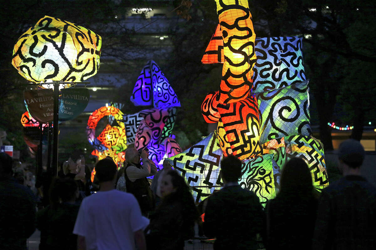 La Villita is lit with artwork from Charles Harriso-Pompa as Luminaria is held in downtown San Antonio on March 9, 2013.