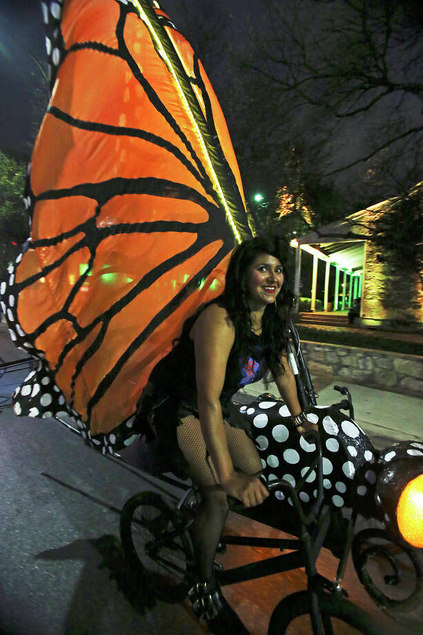 Belinda Pearl rides her buckeye moth sidecar bike as Luminaria is held in downtown San Antonio on March 9, 2013. Photo: Tom Reel, San Antonio Express-News