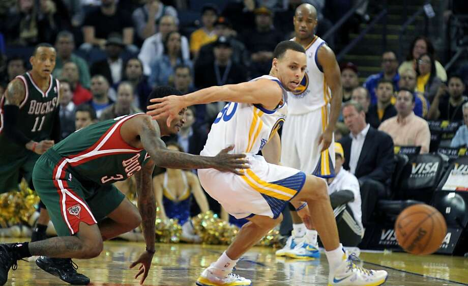Golden State Warriors guard Stephen Curry (30) looses control of the ball during their NBA basketball game with the Milwaukee Bucks Saturday, March 9, 2013, in Oakland Calif. Photo: Lance Iversen, The Chronicle