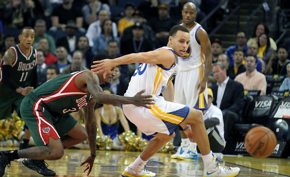 Golden State Warriors guard Stephen Curry (30) looses control of the ball during their NBA basketbal