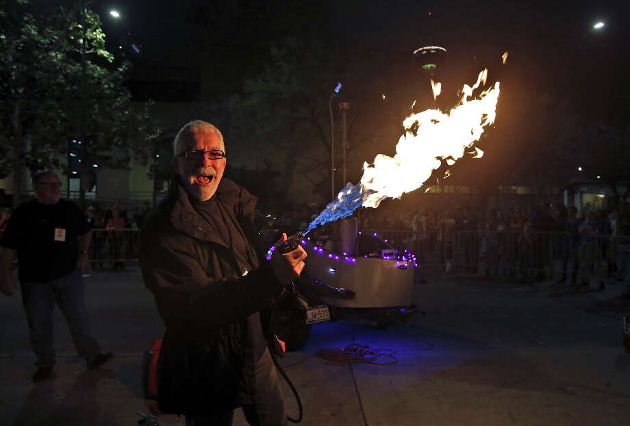 Pepper Mouser throws a flame out over an art car called Roachster as Luminaria is held in downtown San Antonio on March 9, 2013. Photo: Tom Reel, San Antonio Express-News