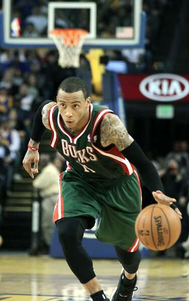 Milwaukee Bucks guard Monta Ellis drives the ball down court against the Golden State Warriors in th