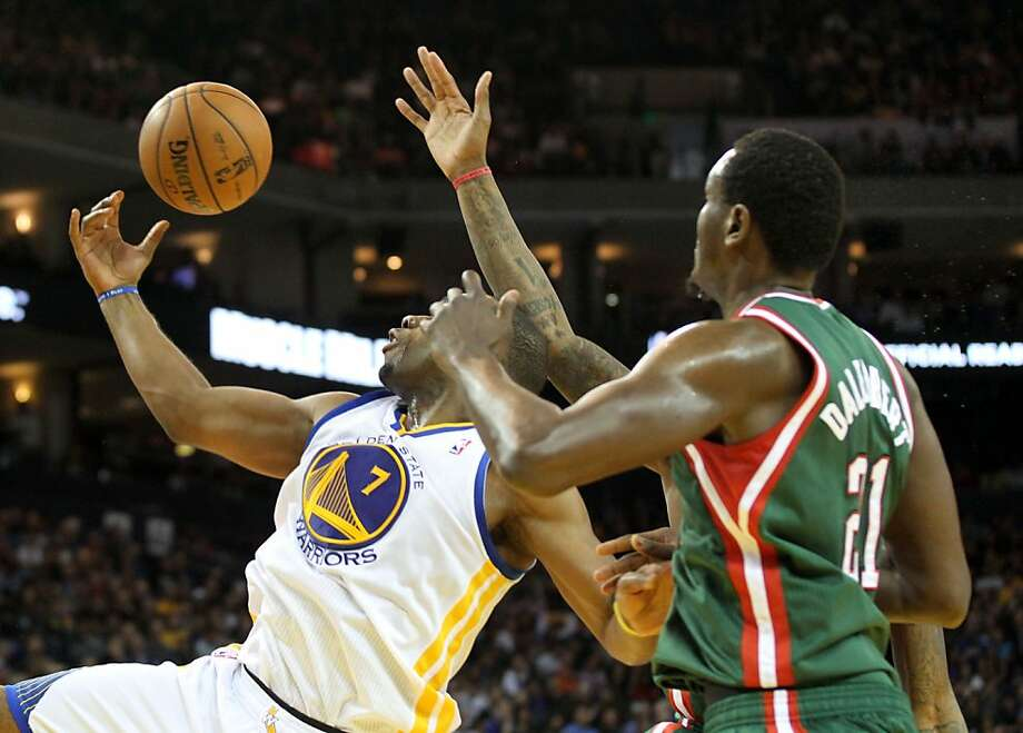 Golden State Warriors forward Carl Landry (7)and Milwaukee Bucks Samuel Dalembert (21) battle for a rebound in the second half of their NBA basketball game Saturday, March 9, 2013, in Oakland Calif. Photo: Lance Iversen, The Chronicle
