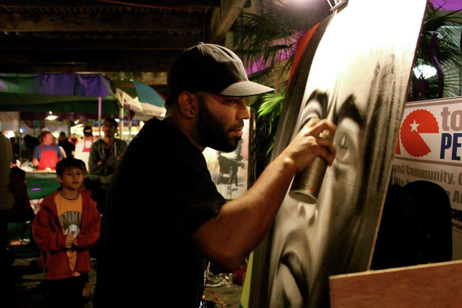 Art lovers pack downtown San Antonio to take in the sights at Luminaria on Saturday night, March 9, 2013. Photo: Yvonne Zamora, MySA.com