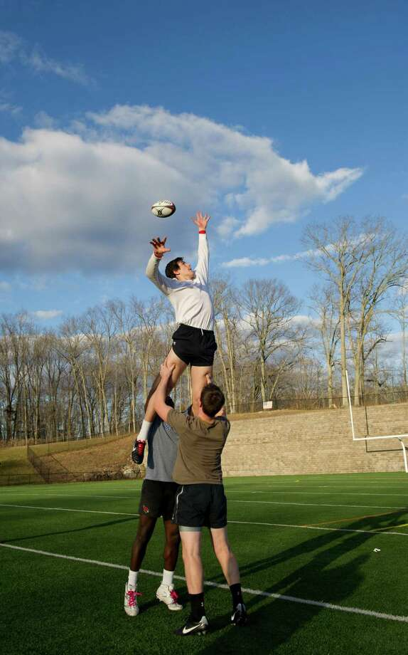 Erik Tack is lifted during Tuesday's rugby practice at Greenwich High School on March 5, 2013. Photo: Lindsay Perry / Stamford Advocate