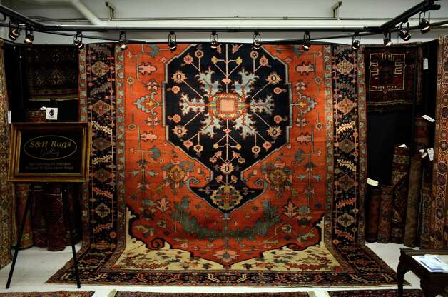 S&H Rugs Gallery hung big beautiful Persian and Caucasian rugs on Saturday, March 2, 2013, at the 46th Annual Darien Antiques Show in Darien, Conn. Photo: Jeanna Petersen Shepard / Darien News freelance Jeanna Petersen Shepard