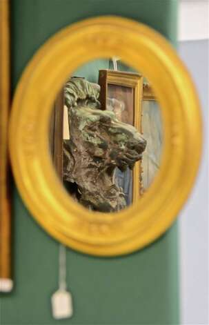 A lion through the looking glass, on Saturday, March 2, 2013, at the 46th Annual Darien Antiques Show in Darien, Conn. Photo: Jeanna Petersen Shepard / Darien News freelance Jeanna Petersen Shepard