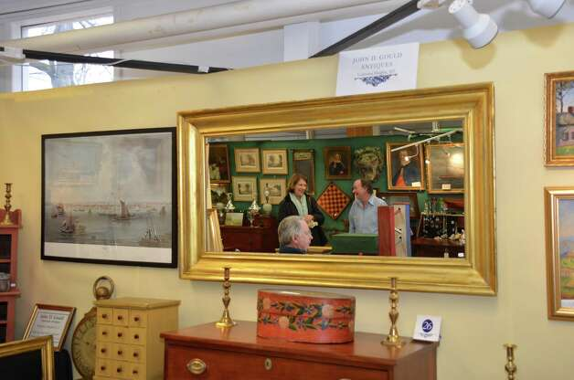 A mirror frames the action in the John D. Gould Antiques section on Saturday, March 2, 2013, at the 46th Annual Darien Antiques Show in Darien, Conn. Photo: Jeanna Petersen Shepard / Darien News freelance Jeanna Petersen Shepard