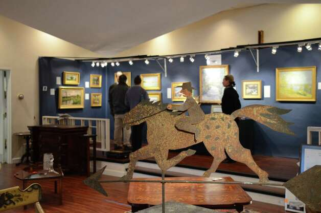 A weathervane gallops through the gallery on Saturday, March 2, 2013, at the 46th Annual Darien Antiques Show in Darien, Conn. Photo: Jeanna Petersen Shepard / Darien News freelance Jeanna Petersen Shepard