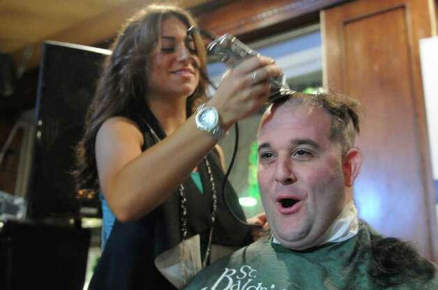 Jaclyn Rotante gives Chad Armstrong a shave during the annual St. BaldrickâÄôs Foundation Head-Shaving fundraiser to benefit childhood cancer research at BradfordâÄôs Grill and Tavern in Stamford. This year's event will take place 6 p.m. Thursday, March 14, at Bradford's. Photo: Keelin Daly / Stamford Advocate