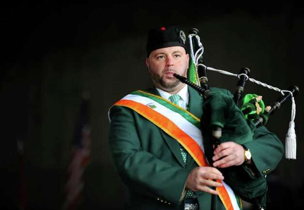 Ray Collette, of Bridgeport, marches with the Greater Bridgeport St. Patrick's Day Celebration Committee during the 30th annual parade through downtown Bridgeport Friday, Mar. 16, 2012. This year's parade will kick off at noon Friday, March 15. Photo: Autumn Driscoll / Connecticut Post