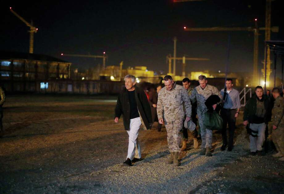 Defense Secretary Chuck Hagel walks with U.S. Marine General Joseph Dunford, Commander of the International Security Force upon Hagel's arrival near Camp Eggers in Kabul, Afghanistan, Friday. Hagel arrived in Afghanistan Friday for his first visit as Pentagon chief, saying that there are plenty of challenges ahead as NATO hands over the country's security to the Afghans. Photo: AP