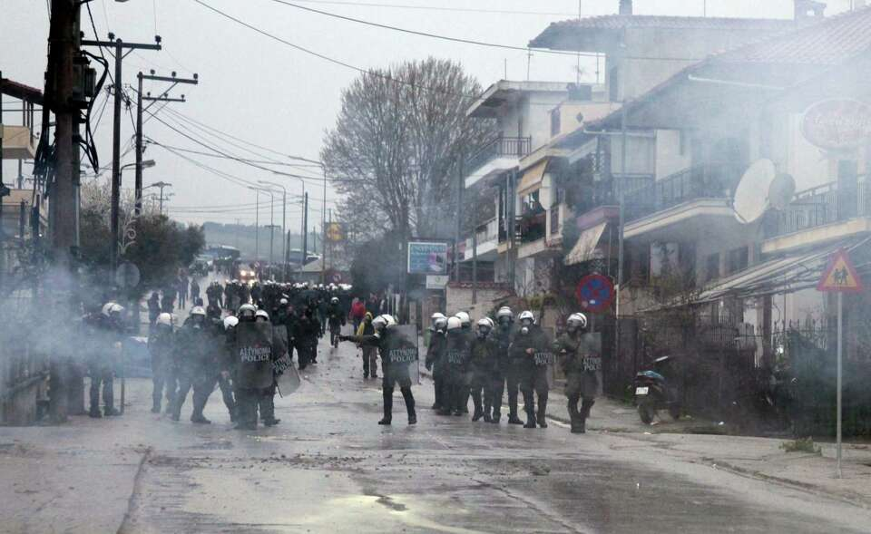 Riot police occupy the central street during protest in the village of Ierissos, located on the nort