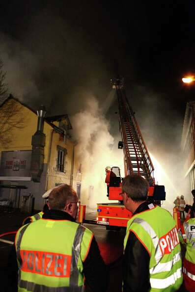 Firefighters extinguish a fire in a building in Backnang, Germany,  Sunday. An early-morning fire Su