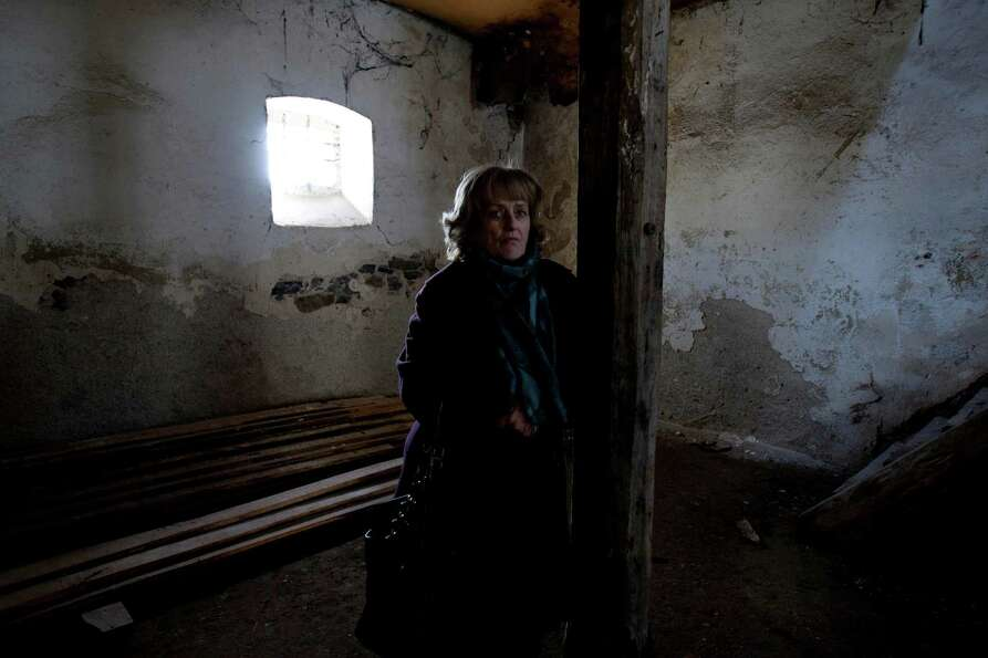 Muslim Bosniak woman Nusreta Sivac poses for photo in a war-destroyed house in Sanski Most, 260 kms