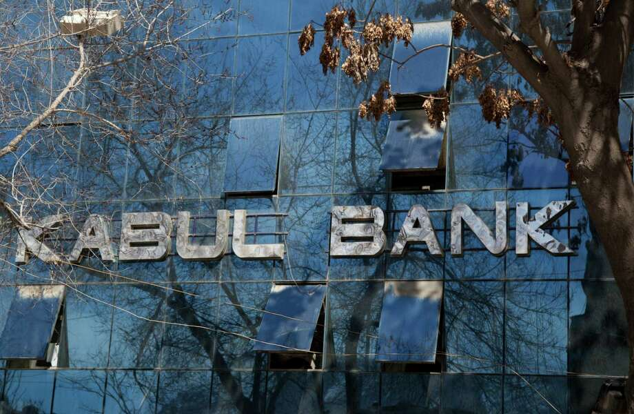 An exterior view of the Kabul Bank in the center of Kabul, Afghanistan, on Tuesday. An Afghan tribunal convicted two top executives of the Kabul Bank, renamed the New Kabul Bank after the scandal broke, and sentenced them to five-year prison terms on Tuesday for their role in a massive corruption scandal that led to the collapse of Afghanistan's largest bank and threatened the country's fragile economy. The bank's former chairman Sherkhan Farnood and former chief executive officer Khalilullah Ferozi were found guilty of theft of $278 million and $530 million, respectively. Farnood and Ferozi have also been ordered to pay back these funds. Photo: AP