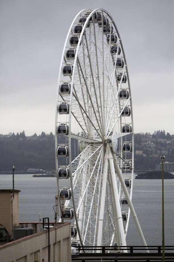 The Seattle Great Wheel slowly turns on Thursday, Feb. 28, 2013, in Seattle. (Jordan Stead, seattlepi.com)