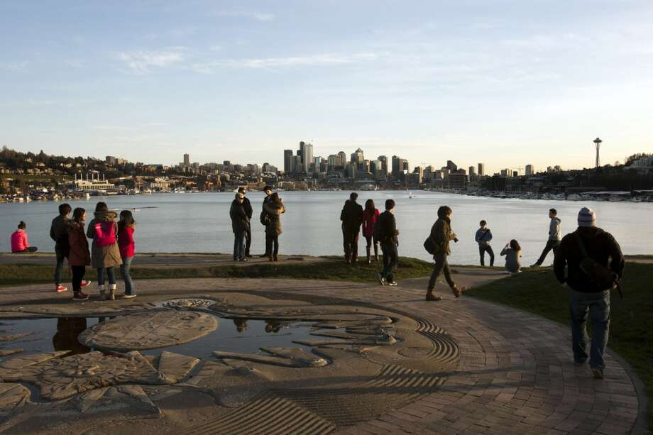 Onlookers enjoy a sunset at Gas Works Park on Monday, March 4, 2013, in Seattle. (Jordan Stead, seattlepi.com)