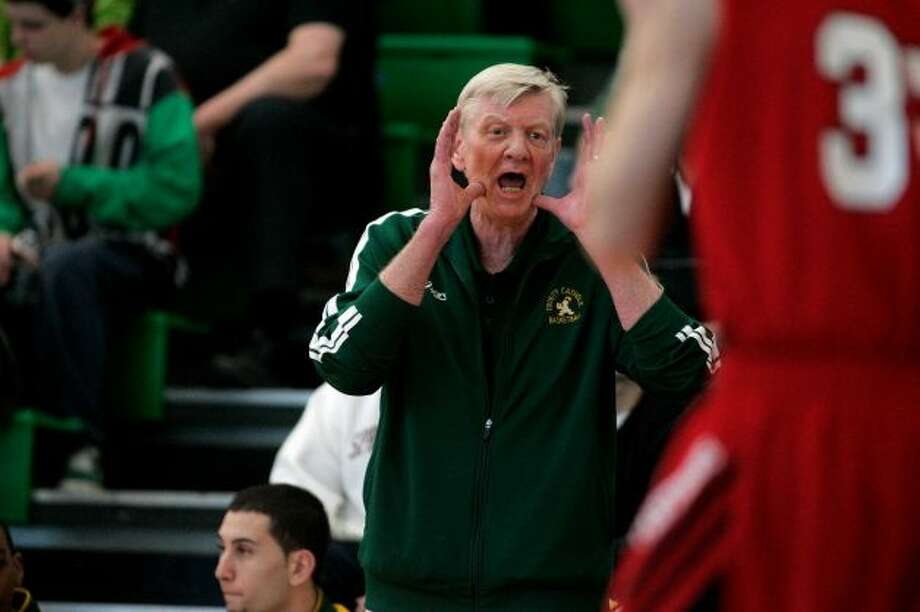Trinity Catholic coach Mike Walsh shouts instructions to his team during Saturday's win over E.O. Smith.