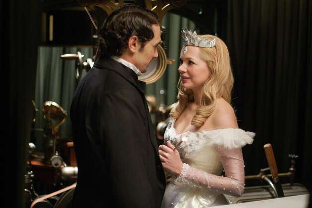 "This film image released by Disney Enterprises shows James Franco, left, and Michelle Williams in a scene from ""Oz the Great and Powerful."" (AP Photo/Disney Enterprises, Merie Weismiller Wallace) Photo: Merie Weismiller Wallace"