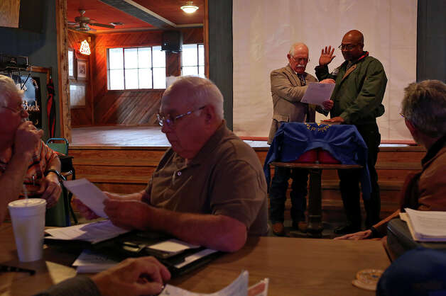 Dwayne Williams, right, of Angleton, is sworn in as the representative for Brazoria County by Don Ballard, left, with members of the Republic of Texas government at the Silver Eagle Taphouse in McQueeney during their monthly meeting on Saturday, Feb. 9, 2013. Photo: Lisa Krantz, San Antonio Express-News / San Antonio Express-News