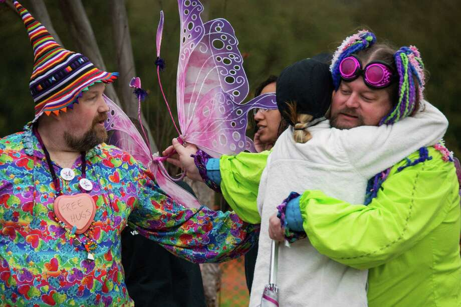 "Dim n Wit, the Fairy Brothers, make good on their promise of ""Free Hugs"" as they encourage walkers along Allen Parkway. Photo: Smiley N. Pool, Houston Chronicle / © 2013  Houston Chronicle"