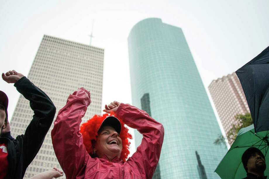Sandra Ricks dances with other walk participants during ceremonies kicking off the 24th Annual AIDS Walk Houston. Photo: Smiley N. Pool, Houston Chronicle / © 2013  Houston Chronicle