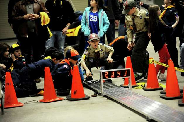 Scout Ryan Miklautsch, 10, watches his car during the Greenwich Cub Scouts race in pinewood derby  at Greenwich Police Department in Greenwich, Conn., Sunday March 10, 2013. Photo: Helen Neafsey / Greenwich Time