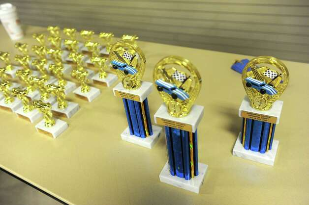 Trophies stand waiting for the winners at the Greenwich Cub Scouts race in pinewood derby at Greenwich Police Department in Greenwich, Conn., Sunday March 10, 2013. Photo: Helen Neafsey / Greenwich Time