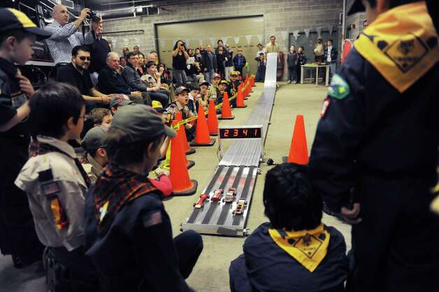 The Greenwich Cub Scouts race in pinewood derby at Greenwich Police Department in Greenwich, Conn., Sunday March 10, 2013. Photo: Helen Neafsey / Greenwich Time
