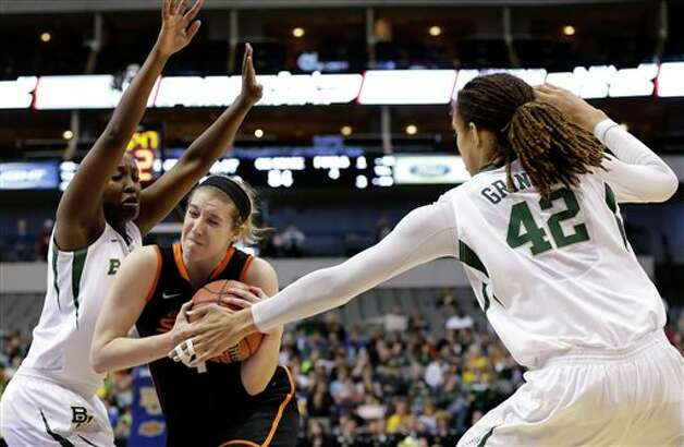 Baylor guard Kimetria Hayden (1) and center Brittney Griner (42) defend against a drive by Oklahoma State forward Liz Donohoe (4) in the second half of an NCAA college basketball game in the Big 12 women's tournament Sunday, March 10, 2013, in Dallas. Donohoe had 20-points in the 77-69 loss to Baylor.  (AP Photo/Tony Gutierrez) Photo: Tony Gutierrez, Associated Press / AP