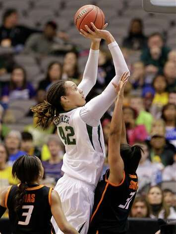 Baylor center Brittney Griner (42) goes up for a shot over Oklahoma State's Tiffany Bias (3) and Kendra Suttles (31) in the second half of an NCAA college basketball game in the Big 12 women's tournament Sunday, March 10, 2013, in Dallas. Griner had a game-high 30-points in the  77-69 Baylor win. (AP Photo/Tony Gutierrez) Photo: Tony Gutierrez, Associated Press / AP