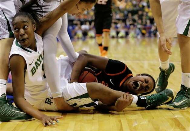 Baylor guard Jordan Madden, bottom left, looks toward an official waiting for a call as Oklahoma State forward Toni Young (15) scrambles on the floor for a turnover by Baylor in the second half of an NCAA college basketball game in the Big 12 women's tournament Sunday, March 10, 2013, in Dallas. Baylor's Brittney Griner, top left, and Alexis Prince, top right, watch in the 77-69 Baylor win.   (AP Photo/Tony Gutierrez) Photo: Tony Gutierrez, Associated Press / AP