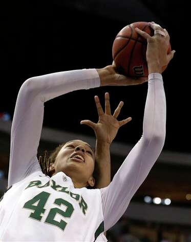 Baylor' Brittney Griner (42)eludes an Oklahoma State defender as she goes up for a score in the first half of an NCAA college basketball game in the Big 12 women's tournament Sunday, March 10, 2013, in Dallas. (AP Photo/Tony Gutierrez) Photo: Tony Gutierrez, Associated Press / AP