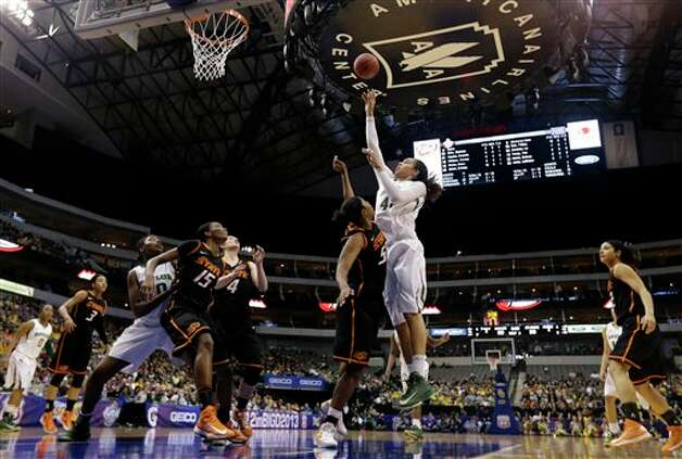 Baylor' Brittney Griner (42) attempts a shot over Oklahoma State' LaShawn Jones (55) in the first half of an NCAA college basketball game in the Big 12 women's tournament Sunday, March 10, 2013, in Dallas. (AP Photo/Tony Gutierrez) Photo: Tony Gutierrez, Associated Press / AP
