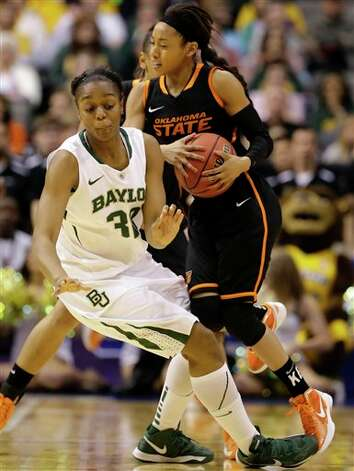 Baylor' Brooklyn Pope (32) and Oklahoma State guard Tiffany Bias (3) collide while chasing a loose ball in the first half of an NCAA college basketball game in the Big 12 women's tournament on Sunday, March 10, 2013, in Dallas. (AP Photo/Tony Gutierrez) Photo: Tony Gutierrez, Associated Press / AP