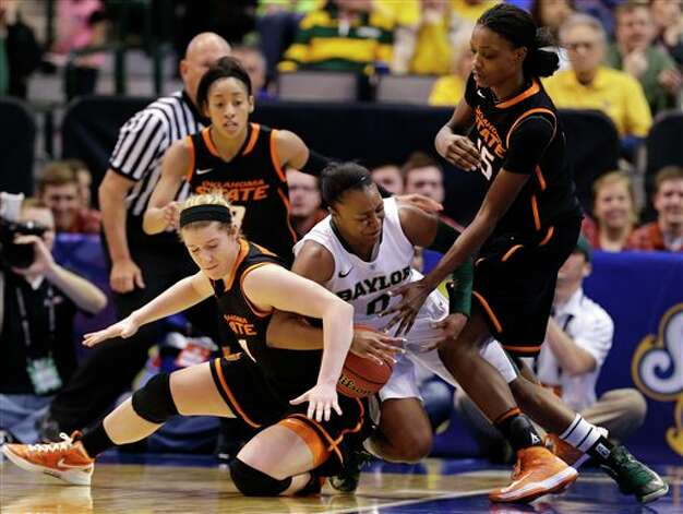 Baylor's Odyssey Sims (0) competes with Oklahoma State's Liz Donohoe, bottom left, and Toni Young (15) for a loose ball as Oklahoma State's Tiffany Bias, rear, watches in the second half of an NCAA college basketball game in the Big 12 women's tournament on Sunday, March 10, 2013, in Dallas. Baylor won 77-69. (AP Photo/Tony Gutierrez) Photo: Tony Gutierrez, Associated Press / AP